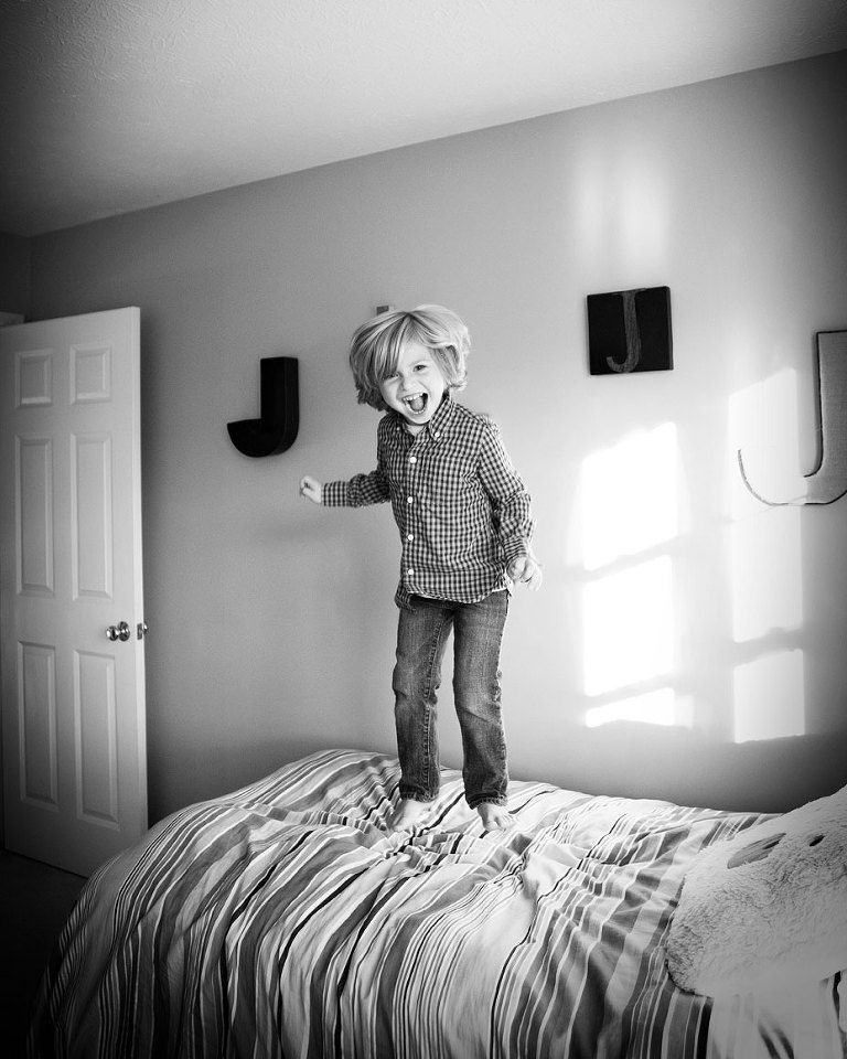 jumping-on-bed-kids-lifestyle-photographer-rochester-ny